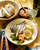 Grilled tuna steak with spicy dip and lemons