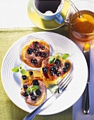 Blueberry pancakes on plate; cup of coffee, honey