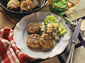 Fish rissoles with nuts and salad