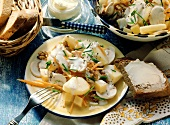 Potato salad with mushrooms, carrots, diced cheese and nuts