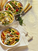 Three different pasta salads in bowls
