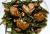 Roast quail breasts on bean salad with walnuts