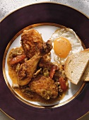 Chicken ragout Marengo with fried egg & toast