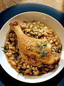 Cassoulet with duck leg in deep plate