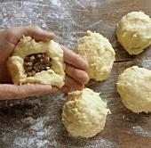 Preparing stuffed - gefillte potato dumplings