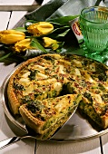 Broccoli and asparagus quiche, a piece cut on plate