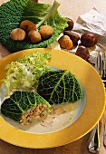 Savoy leaves stuffed with chestnuts with mushroom sauce