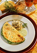 Omelette with spinach & cheese filling, wild rice & herb sauce