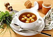 Clear Soup with Turkey Dumplings in Soup Mug