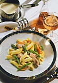 Penne with salmon & asparagus sauce, carrots & mangetouts