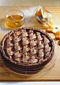 Dark wholemeal Linzer torte with dried fruits