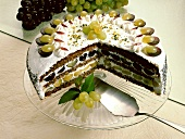 Grape cream gateau, pieces cut, on cake plate