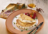 Pancake with quark and raisin filling served on a plate