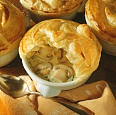 Mushroom soup with button mushrooms under puff pastry