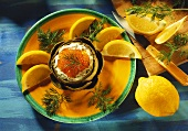 Artichoke stuffed with Garlic Yogurt and Trout Caviar with Dill and Lemon Wedges