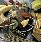 Dipping Assorted Fruit into Chocolate Fondue