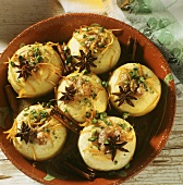 Baked apples with anise stars and julienned orange peel