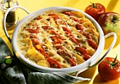 Potato and tomato bake with sunflower seeds