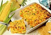 Rice bake with sweetcorn, pineapple, peas & salmon