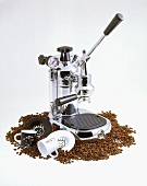 Espresso Machine and Two Cups Surrounded by Coffee Beans