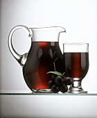 Grape Juice in a Decanter and in a Glass; Grapes