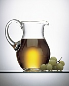 White Grape Juice in a Pitcher; Grapes