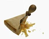 A piece of Parmesan with Parmesan knife