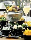 Several Vegetables for Fondue; Fondue Pot with Potatoes