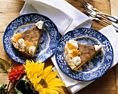 Two pieces of pumpkin pie on plates