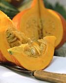 An orange pumpkin (Hokkaido), cut open