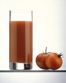 Tall Glass of Tomato Juice with Tomatoes