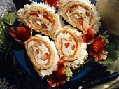 Four slices of sponge roulade with mascarpone & strawberries