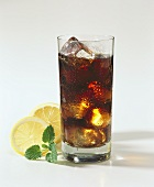 A Glass of Coke with Ice Cubes; Lemon Slices