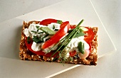 Crispbread with quark, peppers, spring onion and herbs