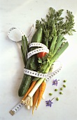 Assorted Vegetables with a Tape Measure Around Them
