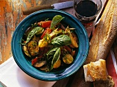 Ratatouille with basil and white bread stick