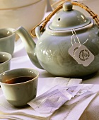 Green Tea in Cups and Pot