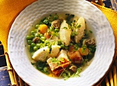 A Bowl of Gnocchi and Bacon Soup; Fresh Parsley