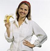 A Woman Holding a Partially Peeled Banana