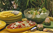 Two Assorted Salads on a Buffet Table Outdoors