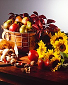 Apples in a Basket with Sunflowers and Nuts