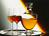 A Decanter and Two Glasses of Brandy on a Tray