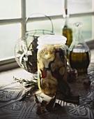 Pickled Artichokes in a Glass Jar on a Window Sill