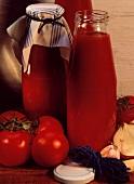 Bottles of Homemade Tomato Sauce; Tomatoes