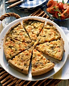 Quiche with button mushrooms & diced tomatoes, cut into pieces