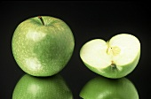 Whole and Half of a Granny Smith Apple
