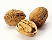 Three Walnuts; Two Whole and One Halved
