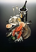Still life: raw fish, lobster,  scallops, oysters, champagne