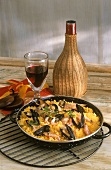 Paella in Pan; Red Wine Decanter and Glass