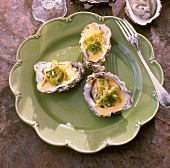 Saffron oysters with leeks on plate (from Ireland)